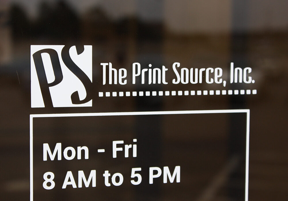 The Print Source, Inc. front window signage and hours of operation